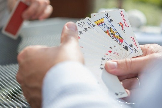Poker player choosing the right card